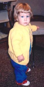 Hannah wearing the yellow sweater Great Aunt Marge knitted for her.