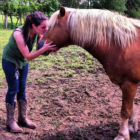 Sister Rita with a horse.