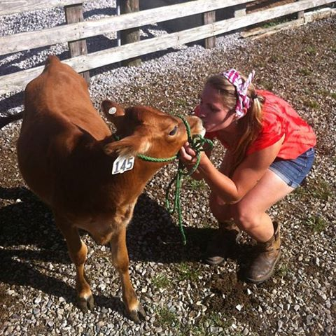 Joy kisses a jersey cow