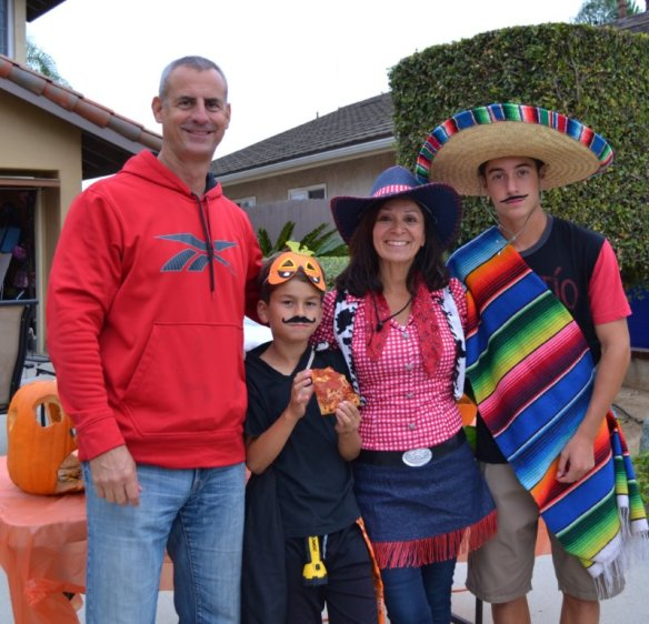 My son and his family Halloween night. Hard to believe the adults qualify for AARP. The kids are proud of their Spanish heritage.