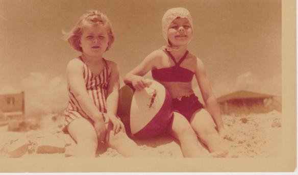 My sister Michelle and me at Myrtle Beach in 1947 when we lived there and the ocean was at our front door.