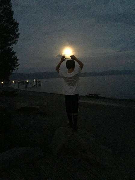 Granson Sean catching the moon in San Diego CA, Wendy Johnston, 2015