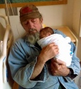 Granddad in his work clothes. He held her hand through the delivery.